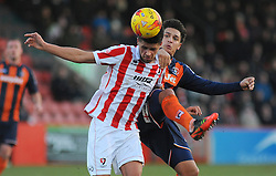 Cheltenham Town's  Kane Ferdinand challenges for the ball against Luton Town's Nathan Doyle - Photo mandatory by-line: Nizaam Jones - Mobile: 07966 386802 - 24/01/2015 - SPORT - Football - Cheltenham - Whaddon Road - Cheltenham Town v Luton Town - Sky Bet League Two.