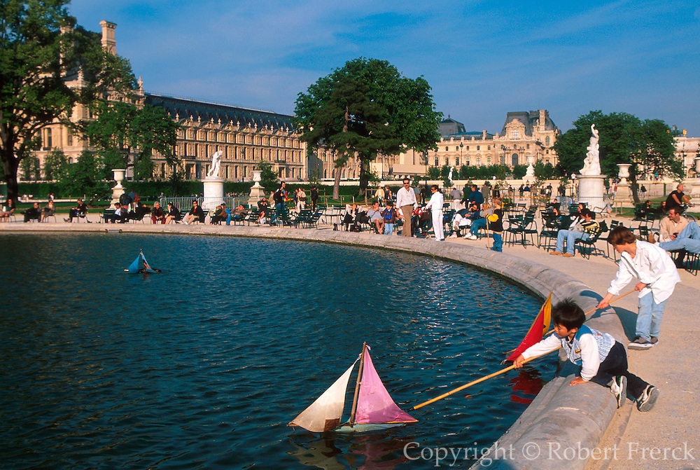 FRANCE, PARIS, CITY CENTER Jardin des Tuileries, the Tuileries Gardens children sailing boats on the lake