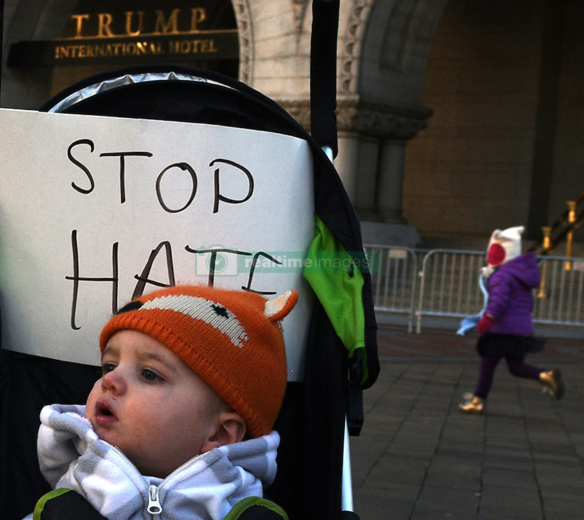 """December 10, 2016 - Washington, DC, USA - DAVID DASCHER sits in stroller with sign saying ''Stop Hate.'' His mother was very excited about a kid-friendly event and brought him from Philadelphia PA. Children's Rally for Kindness takes place at Trump International Hotel in Washington DC on December 10, 2016 organized by the Takoma Parents Action Coalition.  According to their FaceBook page, it was a call to President-elect Donald Trump: ''to remember these lessons as he prepares to take office and implement policies that will affect the lives of children and families across our diverse nation.''.''All over the world, across cultures and countries, children learn the same basic lessons: .Ã'be kind,Ã"""" .Ã'tell the truth,Ã"""" .Ã'be fair,Ã"""" .Ã'respect everyone,Ã"""" .Ã'treat others the way you want to be treated,Ã"""" .Ã'donÃ•t touch others if they donÃ•t want to be touched. (Credit Image: © Carol Guzy via ZUMA Wire)"""