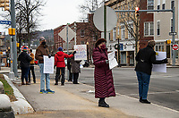 Supporters for the resignation of Dawn Johnson North Main Street in downtown Laconia on Monday morning.  (Karen Bobotas Photo/for The Laconia Daily Sun)