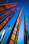 """Seattle Space Needle and """"Bamboo"""" sculpture at Seattle Center. Seattle Center is a park and arts and entertainment center in Seattle, Washington."""