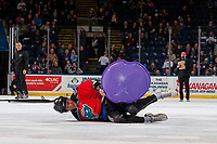 KELOWNA, CANADA - JANUARY 3: A fan falls off his saucer during intermission human bowling at the Kelowna Rockets against the Tri-City Americans on January 3, 2017 at Prospera Place in Kelowna, British Columbia, Canada.  (Photo by Marissa Baecker/Shoot the Breeze)  *** Local Caption ***
