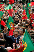 The crowd welcomes Cavaco Silva with national flags in Povoa de Lanhoso, a town in northern Portugal.