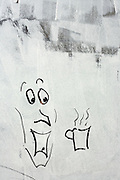 A cartoon picture has been drawn in white emulsion paint, smeared over a shop window, a victim of the UK recession.