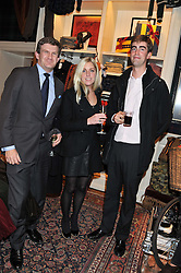 Left to right, The HON.PEREGRINE HOOD, ANTONIA BARCLAY and TOM FABER at a party hosted by TLC to celebrate signing their 5000th member and Ralph Lauren to celebrate the opening of the first Ralph Lauren Rugby store in the UK at 43 King Street, Covent Garden, London on 30th November 2011.