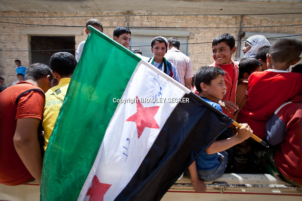 Demonstrators at an anti-government protest in Basheria, Idlib, Syria on Friday 15th June 2012. The weekly demonstrations call for the regime to step down, killings to end, and for democratic change in Syria. Basheria, Idlib, Syria. 15/06/2012