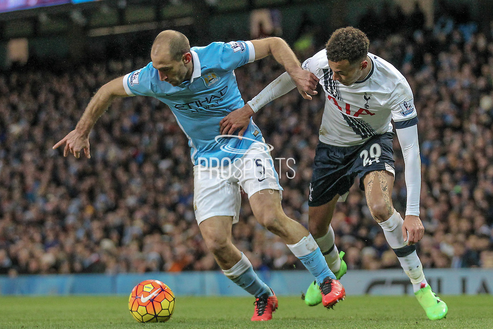 Pablo Zabaleta (Manchester City) and Dele Alli (Tottenham Hotspur) during the Barclays Premier League match between Manchester City and Tottenham Hotspur at the Etihad Stadium, Manchester, England on 14 February 2016. Photo by Mark P Doherty.