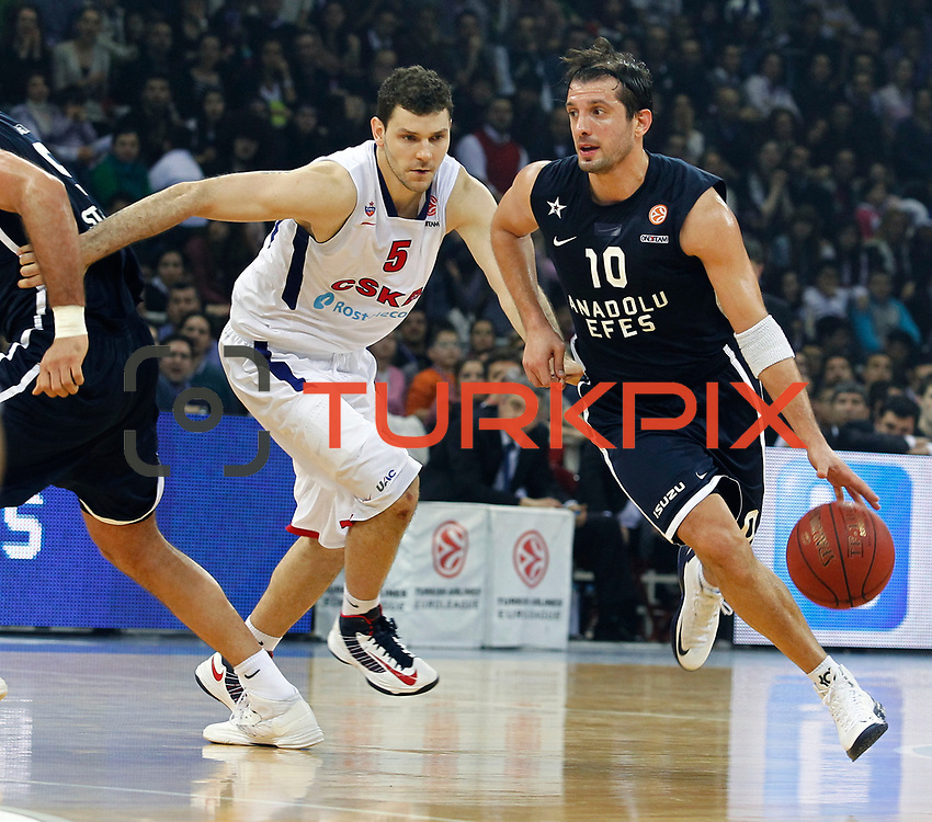 Anadolu Efes's Kerem Tunceri (R) and CSKA Moscow's Vladimir Micov (L) during their Euroleague Top 16 game 8 basketball match Anadolu Efes between CSKA Moscow at the Abdi Ipekci Arena in Istanbul at Turkey on Friday, February, 22, 2013. Photo by TURKPIX