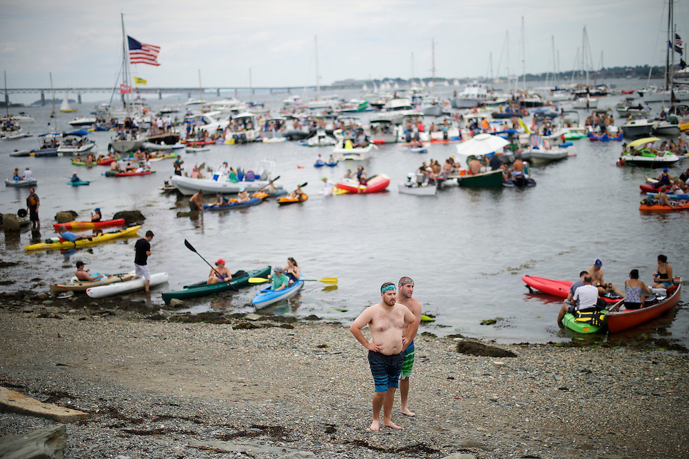 A large gathering of boats congregates near Fort Adams park to listen to performances during the Newport Folk Festival in Newport, RI on July 26, 2014. The three day festival was founded in 1959.