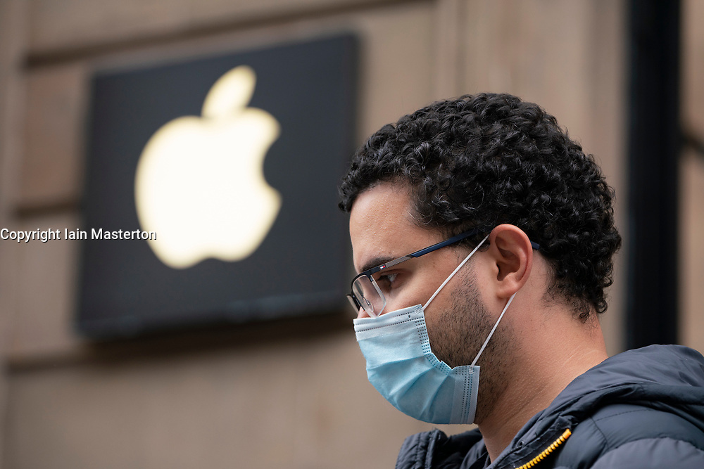 Glasgow, Scotland, UK. 17 July, 2020.  Images from Glasgow city centre as covid-19 restrictions are relaxed and  the public are out and about shopping and at work. Pictured; Man wearing facemark waiting in queue outside Apple shop. Iain Masterton/Alamy Live News