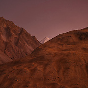 Mountain sunset. Trekking for Kret to Rorung village. Sunset looking south towards the Karakoram mountains – that's mid-September by now we had delayed a bit and I was getting increasingly worried at high altitude snow fall that could prevent us from crossing the pass. The life of the Wakhi people, in the Wakhan corridor, amongst the Pamir mountains. Trekking with Paul Salopek.