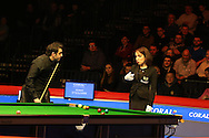 Ronnie O'Sullivan of England talks to referee Malgorzata Kaieska during his 1st round match against Tom Ford of England. Coral Welsh Open Snooker 2017, day 2 at the Motorpoint Arena in Cardiff, South Wales on Tuesday 14th February 2017.<br /> pic by Andrew Orchard, Andrew Orchard sports photography.