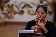"""Susana, component of """"Ensemble de dulces aires """" from Santa Cruz de la Sierra playng at S.Miguel de Velasco's church."""