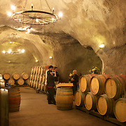 The underground wine cave at the  Gibbston Valley vineyard. The cave has been blasted out of the solid schist of the Central Otago mountains, and creates an ideal natural environment to mature award-winning wines, stored at a constant 12-14°C (53.6-57.2°F). Gibbston Valley Wines, State Highway 6, Queenstown, New Zealand. 23rd March  2011. Photo Tim Clayton.