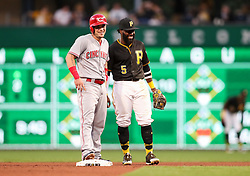 Jun 15, 2018; Pittsburgh, PA, USA; Cincinnati Reds second baseman Scooter Gennett (3) and Pittsburgh Pirates second baseman Josh Harrison (5) both smile during the fifth inning at PNC Park. Mandatory Credit: Ben Queen-USA TODAY Sports