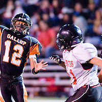 110112       Cable Hoover<br /> <br /> Gallup Bengal Cody Tabaha (12) makes a touchdown pass as Grants Pirate Ttristan Bustos (41) closes in Friday at Public School Stadium.
