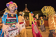 Giant paper-mache puppets called mojigangas dance past the Parroquia church during the week long fiesta of the patron saint Saint Michael September 26, 2017 in San Miguel de Allende, Mexico.