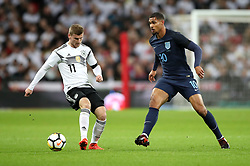 Germany's Timo Werner (left) and England's Ruben Loftus-Cheek (right) battle for the ball during the International Friendly match at Wembley Stadium, London.