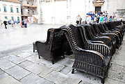 Rows of cane chairs, Dubrovnik old town, Croatia