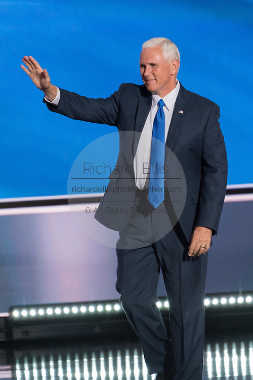 Gov. Mike Pence waves as he walks onstage to addresses delegates as he formally accepts the party's nomination as GOP Vice Presidential  candidate during the third day of the Republican National Convention July 20, 2016 in Cleveland, Ohio.