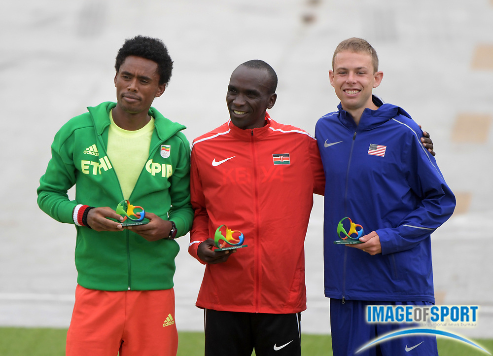 Aug 21, 2016; Rio de Janeiro, Brazil; Marathon gold medalist Eliud Kipchoge (KEN), center, poses with silver medalist Feyisa Lilesa (ETH), left, and bronze medalist Galen Rupp (USA) during the Rio 2016 Summer Olympic Games at Sambodromo.