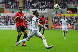 Swansea Defender Chico Flores (ESP) clears from Man Utd Forward Robin van Persie (NED) during the second half of the match - Photo mandatory by-line: Rogan Thomson/JMP - Tel: Mobile: 07966 386802 17/08/2013 - SPORT - FOOTBALL - Liberty Stadium, Swansea -  Swansea City V Manchester United - Barclays Premier League - First round of the 2013/14 season and the first league match for new Man Utd manager David Moyes.