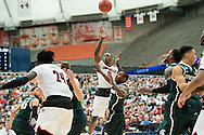 29 MAR 2015: Terry Rozier (0) of the University of Louisville shoots over Lourawis Nairn Jr. of Michigan State University during the 2015 NCAA Men's Basketball Tournament held at the Carrier Dome in Syracuse, NY. Michigan State defeated Louisville 76-70 to advance. Brett Wilhelm/NCAA Photos