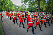The band of the Household division marches past - The Combined Cavalry OCA Parade, Hyde Park. More than two thousand cavalrymen march in a mixture of uniforms or suits with bowler hats and furled umbrellas creating a quintessentially British scene. It is the 93rd Annual Parade and Service of The Combined Cavalry Old Comrades Association at the Cavalry Memorial adjacent and the Bandstand in Hyde Park. Field Marshal Baron Guthrie GCB, LVO, OBE, DL Colonel The Life Guards and Gold Stick took the salute at the march past for both serving and former soldiers of all the Regiments of Regular Cavalry and many Yeomanry Regiments.