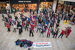 """© Licensed to London News Pictures. 14/12/2019. Bristol, UK. AnExtinction Rebellion flashmob performs a """"disco protest"""" in Bristol's Cabot Circus shopping centre. The event was a protest in reaction to the general election victory yesterday of the Conservatives with Boris Johnson as Prime Minister and a large parliamentary majority. Photo credit: Simon Chapman/LNP."""