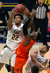 Feb 25, 2021; Berkeley, California, USA; California Golden Bears forward Andre Kelly (22) outleaps Oregon State Beavers forward Warith Alatishe (10) for a rebound during the closing minute of the second half of an NCAA college basketball game at Haas Pavilion. Mandatory Credit: D. Ross Cameron-USA TODAY Sports