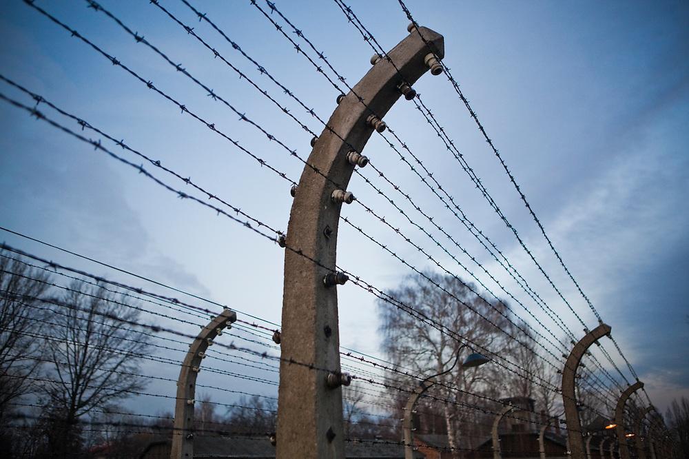 Exterior barbed wire fence, Auschwitz, Poland.