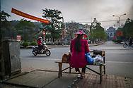 A Vietnamese woman sells lottery tickets along a street in Dien Bien Phu City, Muong Thanh Valley, Dien Bien Province, Vietnam, Southeast Asia