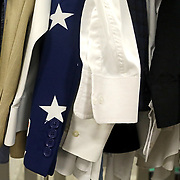 A stars covered jacket hangs on a rack with other jackets at Lauber Clothing in Archbold, Ohio, on Wednesday, July 25, 2018. THE BLADE/KURT STEISS
