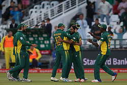 Imran Tahir of South Africa is congratulated by South African captain Faf du Plessis and Kyle Abbott of South Africa for getting Aaron Finch of Australia wicket during the 5th ODI match between South Africa and Australia held at Newlands Stadium in Cape Town, South Africa on the 12th October  2016<br /> <br /> Photo by: Shaun Roy/ RealTime Images