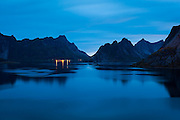The lights of Vindstad across the fjord from Reine, Moskenesoya, Lofoten Islands, Norway.