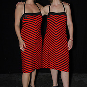 Naomi Blindeman, left, and Corinna Chardon, both of Amsterdam, The Netherlands, pose for a photo before competing in the adult women's latin division of the same-sex ballroom dancing competition during the 2007 Eurogames at the Waagnatie hangar in Antwerp, Belgium on July 13, 2007. ..Over 3,000 LGBT athletes competed in 11 sports, including same-sex dance, during the 11th annual European gay sporting event. Same-sex ballroom is a growing sports that has been happening in Europe for over two decades.