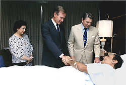 Washington, D.C. - July 5, 1988 -- United States President Ronald Reagan and Vice President George H.W. Bush visit President Jose Napoleon Duarte of El Salvador at Walter Reed Hospital in Washington, DC on July 5, 1988. Mrs. Duarte, left, was also on hand for the bedside visit. Photo by White House/ CNP/ABACAPRESS.COM