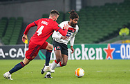 Dundalk's Nathan Oduwa with Rapid Wien's Mateo Barać during the Europa League Round 1 match between Dundalk and SK Rapid Wien at Aviva Stadium, Dublin, Ireland on 26 November 2020.