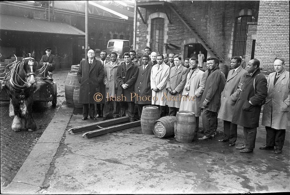 21/02/1963.02/21/1963.21 February 1963.A party of overseas students from U.C.D., T.C.D. and the College of Surgens isiting the distillery of John Jameson and Son Ltd., Bow Street, Dublin.  The group included students from Nigeria, Ghana, Northern Rhodesia, Tanganyika, Kenya, Trinidad and Ceylon. They were accompanied by Mr. B.C. Buckler, Director of the Overseas Students' British Council Office, Dublin and Mr. martin Sheridan, Information Officer, Coras Trachtala/The Irish Export, Board, Dray, Horse, Molly Bán and driver, Jim Tyrell, Jameson's, Irish, Whiskey, jameson,