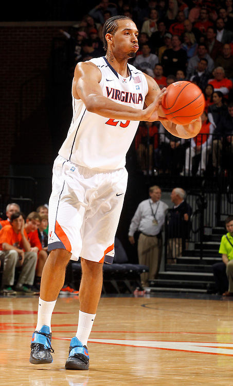 CHARLOTTESVILLE, VA- JANUARY 7: Mike Scott #23 of the Virginia Cavaliers handles the ball during the game against the Miami Hurricanes on January 7, 2012 at the John Paul Jones Arena in Charlottesville, Virginia. Virginia defeated Miami 52-51. (Photo by Andrew Shurtleff/Getty Images) *** Local Caption *** Mike Scott