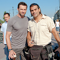 Hollywood actor Hugh Jackman (L) poses with press photographer Ferenc Isza (R) during a commercial shooting for Lipton Ice Tea in Budapest, Hungary on September 02, 2011. ATTILA VOLGYI
