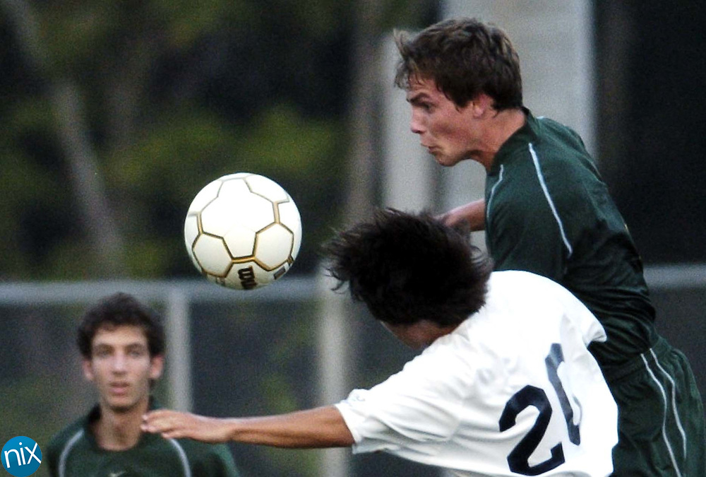 Hickory Ridge's Drew Andriotti (20) and Central Cabarrus' Harley Houston fight for a header Thursday night.