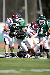 08 September 2012:  Sean Conley gets stopped by Andrew Funsch during an NCAA division 3 football game between the Alma Scots and the Illinois Wesleyan Titans which the Titans won 53 - 7 in Tucci Stadium on Wilder Field, Bloomington IL