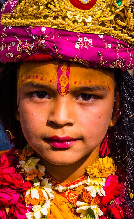 Young girl dressed as Radha (Hindu Goddess and lover and companion of Hindu God Krishna);  Chhadi Mar Holi (local Holi celebration), Holi Festival (Festival of Colors), village of Gokul, near Mathura, Uttar Pradesh, India.