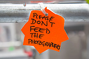 London, UK. Saturday 20th July 2013. A sign reads 'Please don't feed the photographers'. A joke on a zoo sign refering to them as animals. in the press pen opposite the Lindo Wing of St Mary's Hospital, where Kate Middleton, Duchess of Cambridge is due to give birth.