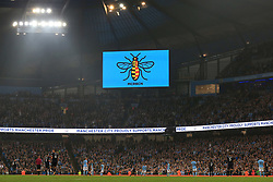 21st August 2017 - Premier League - Manchester City v Everton - A worker bee logo appears on the big screen as a tribute to the victims of the recent terror attacks in Manchester and Barcelona - Photo: Simon Stacpoole / Offside.