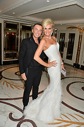 JULIEN MACDONALD and CLAIRE CAUDWELL at a birthday dinner for Claire Caudwell for family & friends held at The Dorchester, Park Lane, London on 24th January 2014.