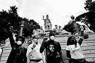 A group of people durign the anti-racist protest in Roma organized by Black Lives Matter movement in memory of George Floyd died in Minneapolis on 25th May due to a violet arrest by a policeman 7th June, 2020 in Roma, Italy.