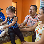 CAPTION: Since frequent visits to Hospital Escuela are required for Keren's speech therapy, she and her parents - who are low earners - need support with accommodation and meals. Fundación Abrigo has therefore come to their aid. The NGO has two shelter houses adjacent to the two largest hospitals in Honduras, including Hospital Escuela in Tegucigalpa. It offers free shelter for patients and family members that come to these two hospitals due to a lack of sufficient healthcare in their home towns and villages. Fundación Abrigo is the only place that offers, at no cost, not only a pleasant and safe place to sleep and rest but also provides the patients and their families with three free meals a day. LOCATION: Fundación Abrigo, Boulevard Sujapa, Tegucigalpa, Honduras. INDIVIDUAL(S) PHOTOGRAPHED: From left to right: Unknown, Keren Sarahi Mijango Iriarte, Jaime Mijango Mejia and Maria Isabel Iriarte Hernandez.