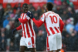 Stoke City's Eric Maxim Choupo-Moting (right) celebrates scoring his side's first goal of the game with teammate Kurt Zouma